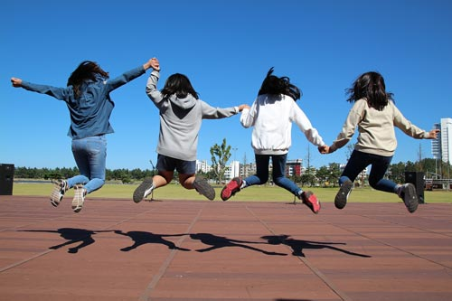 Children jumping and holding hands